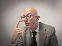 bigstock-Lying-businessman-observing-hi-25876415